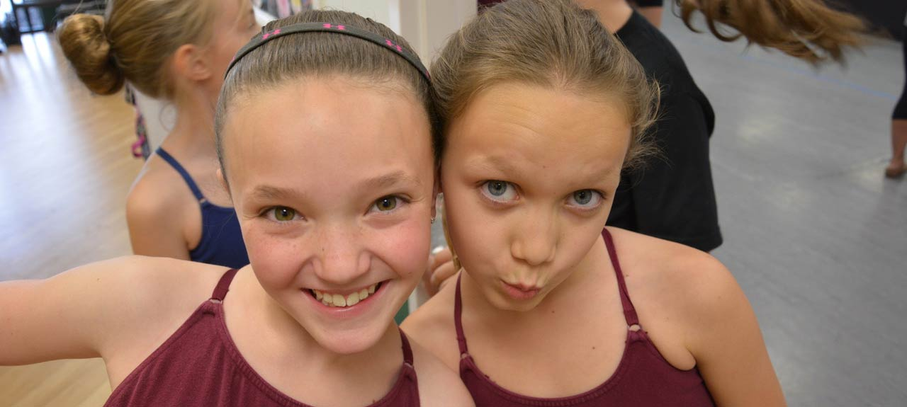 photo of two friends at dance