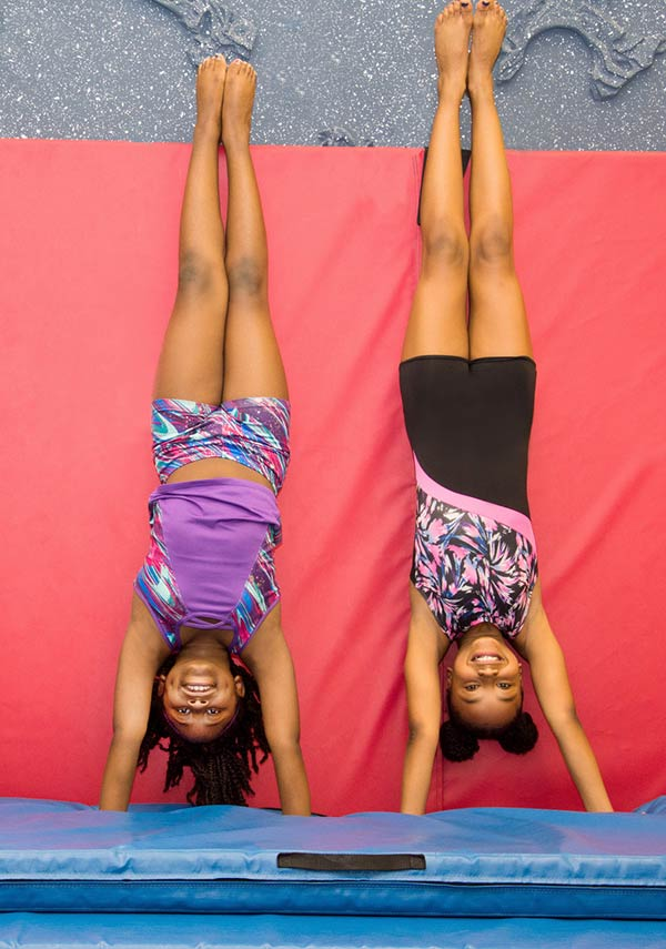 picture of two girls doing a handstand