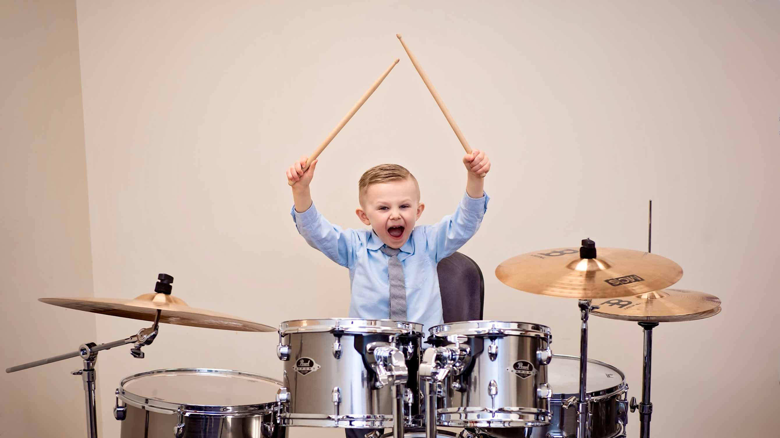 Photo of little boy drumming
