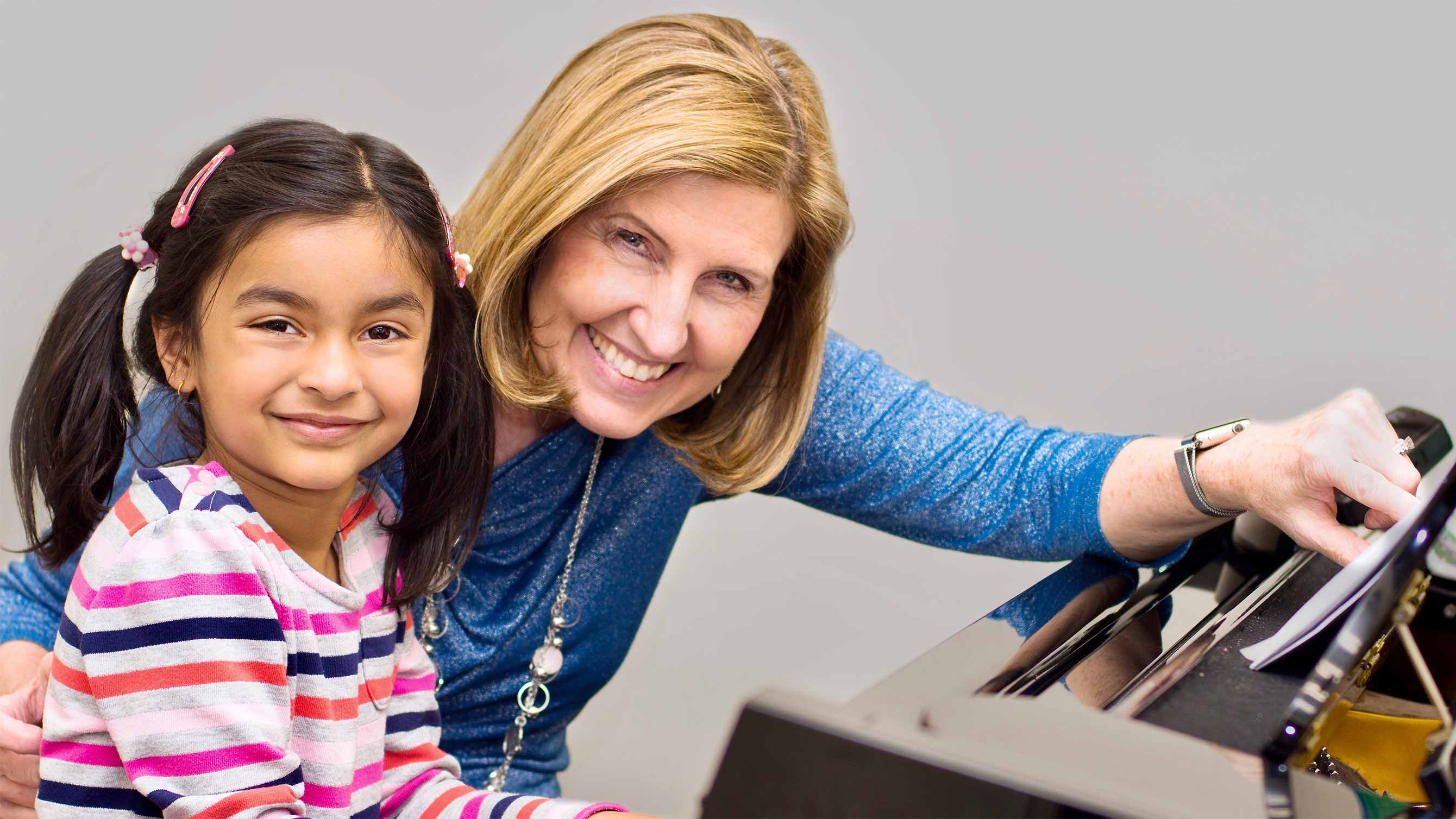Photo of girl in piano lesson