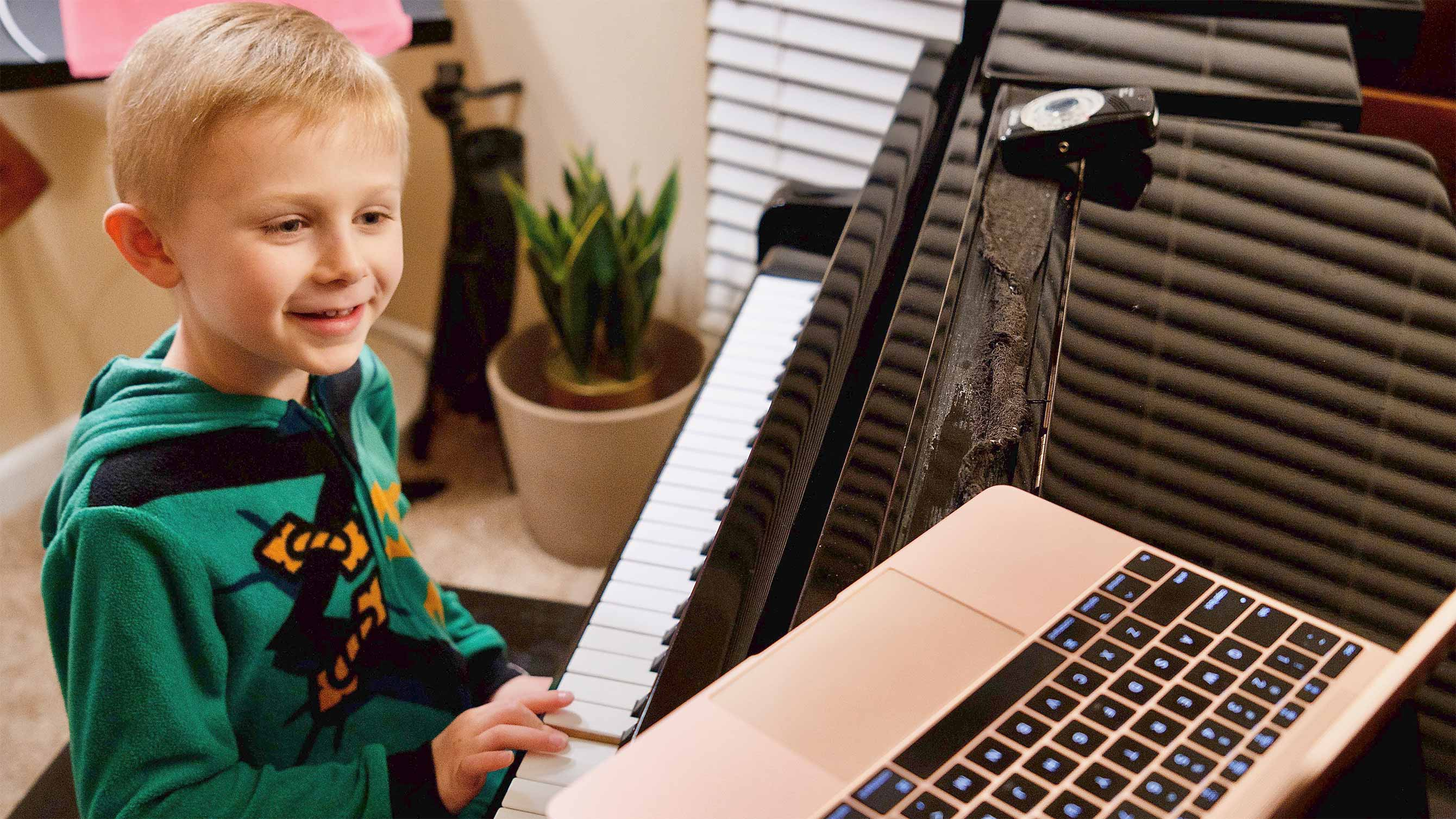 Photo of child taking online piano lesson
